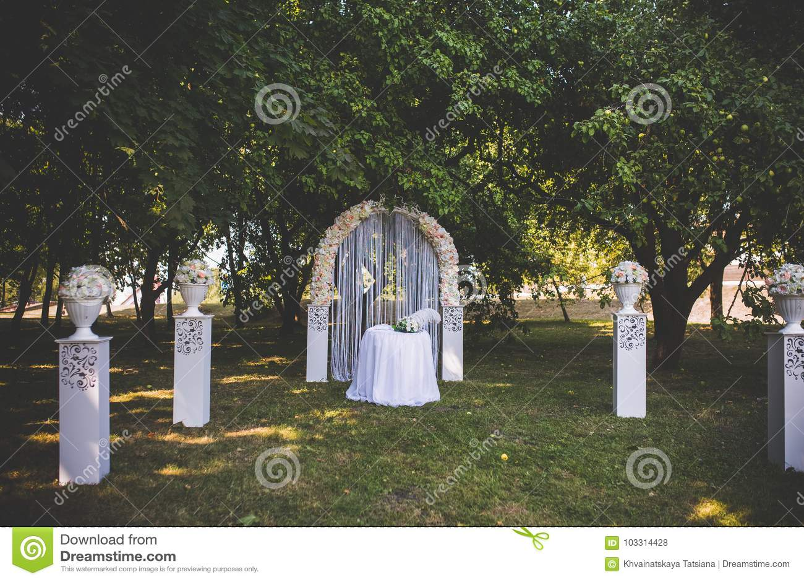 Wedding decorations flowers in a white vase table and wedding arch download wedding decorations flowers in a white vase table and wedding arch festive junglespirit Gallery