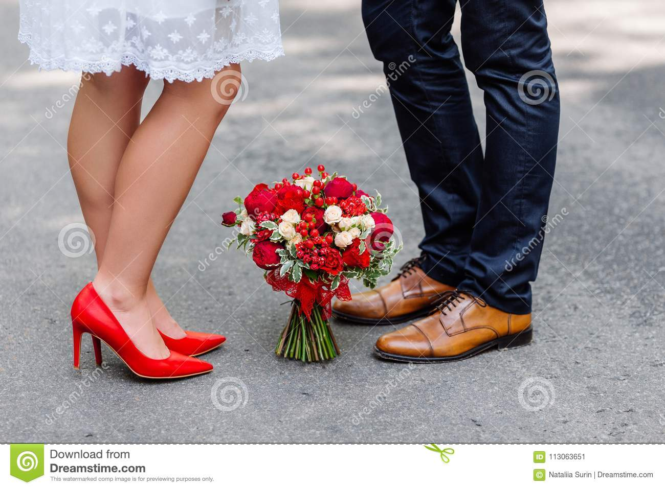Wedding details  stylish red and brown shoes of bride and groom. Bouquet of  roses bf715c375