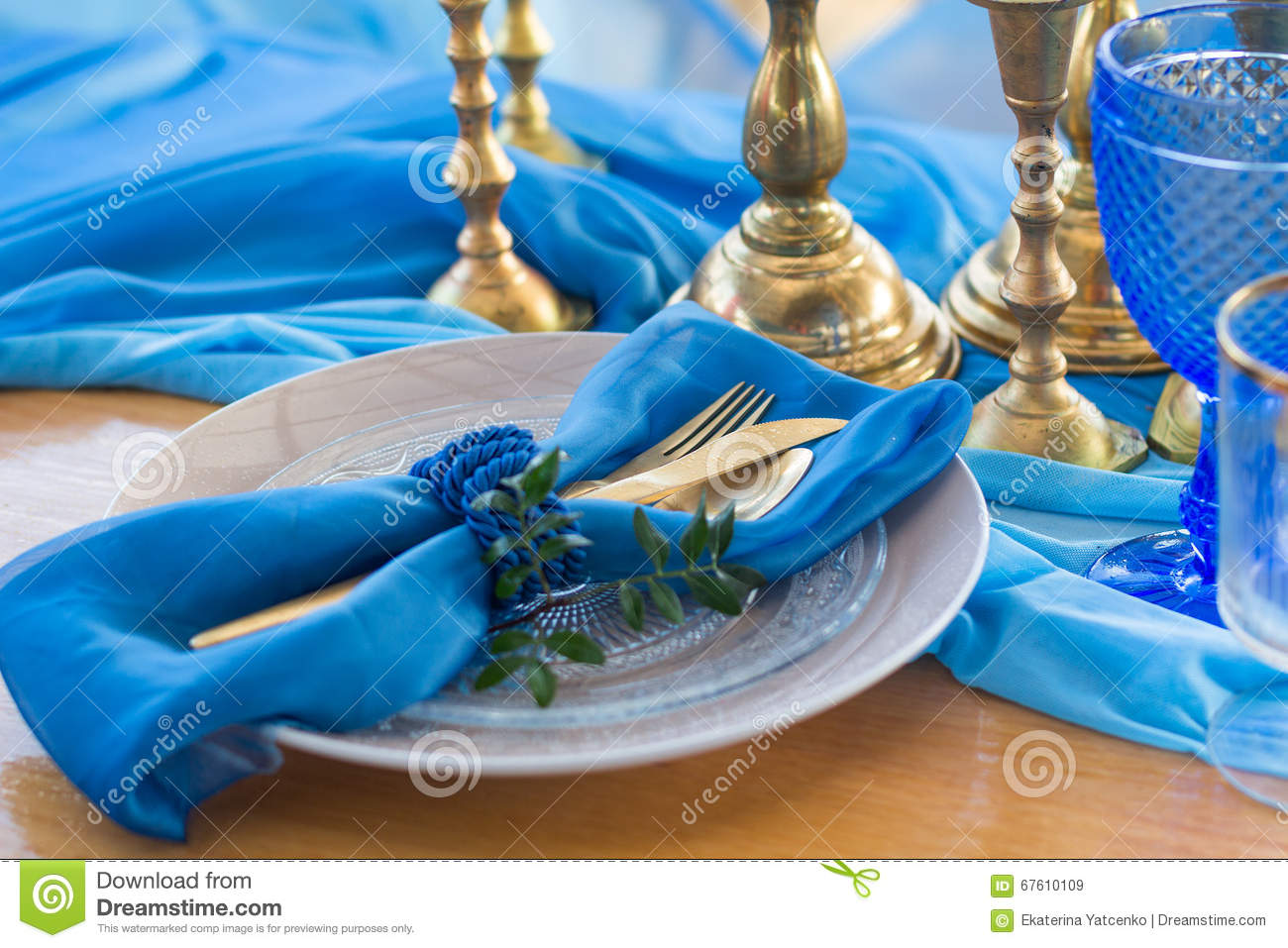 Wedding dinner table detail in white, gold and blue color. Selec