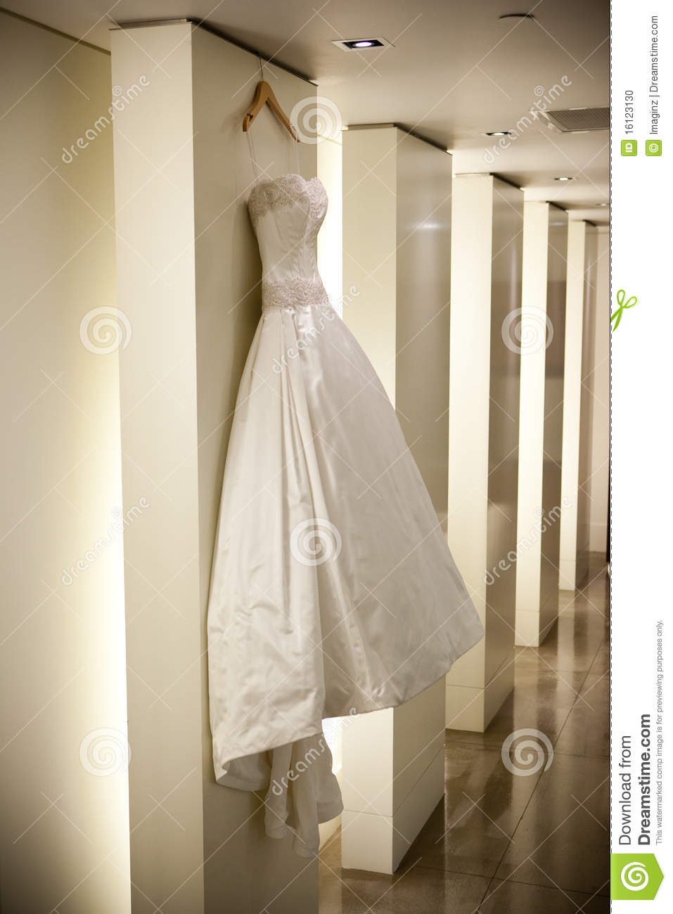 how to hang a wedding dress with a train