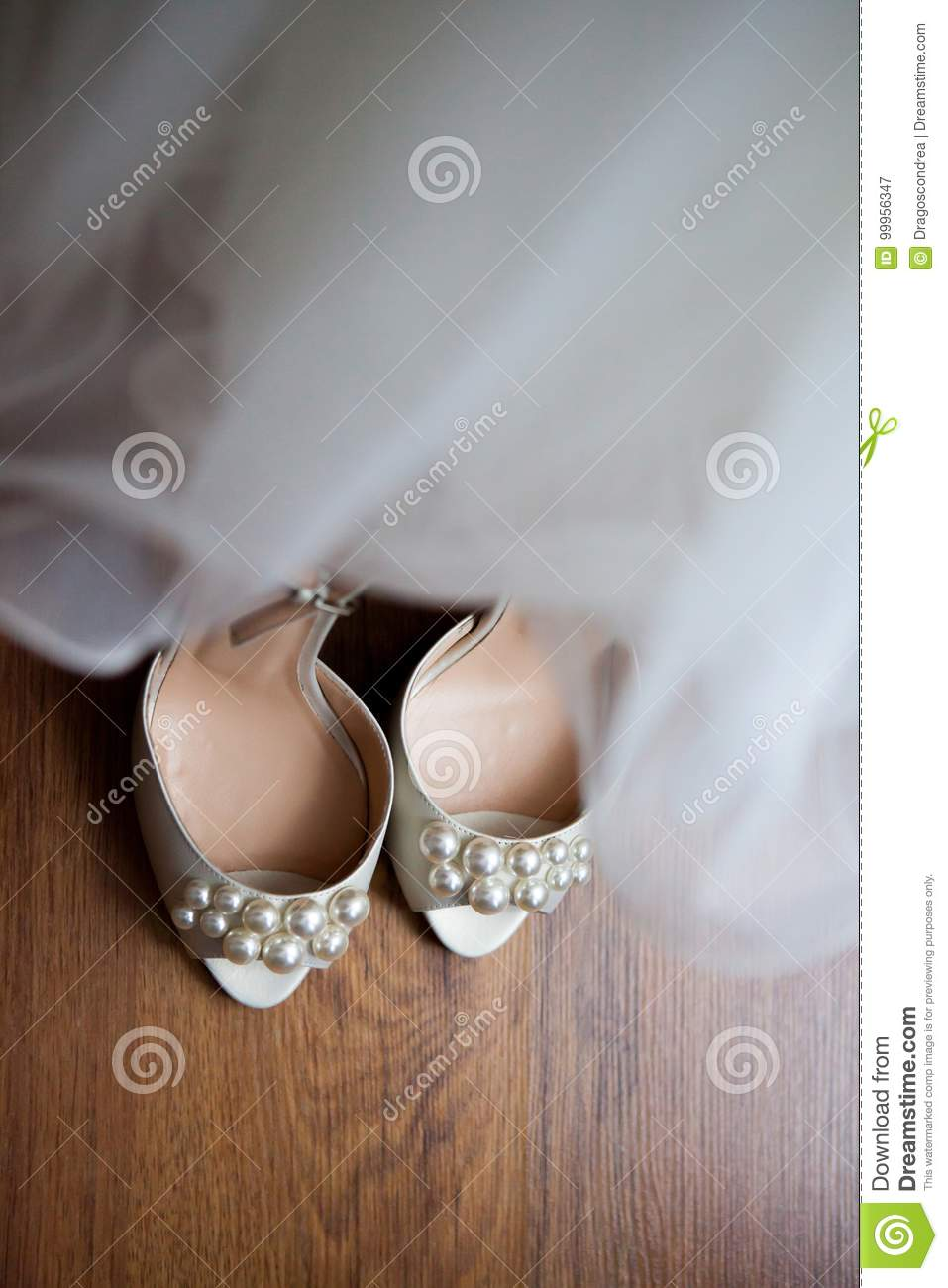 Wedding dress and shoes in a room