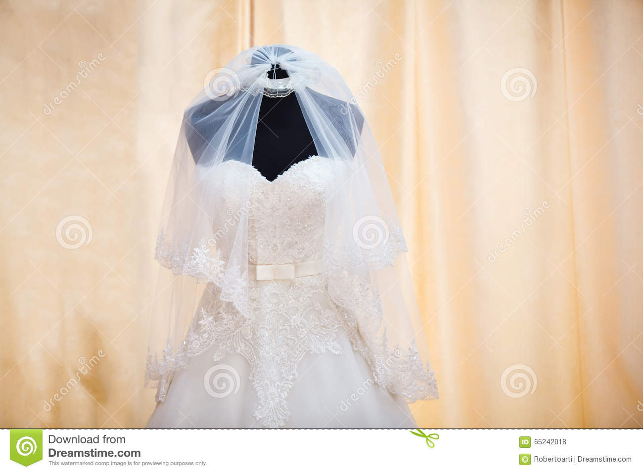 Wedding Dress And Veil On Mannequin Stock Photo