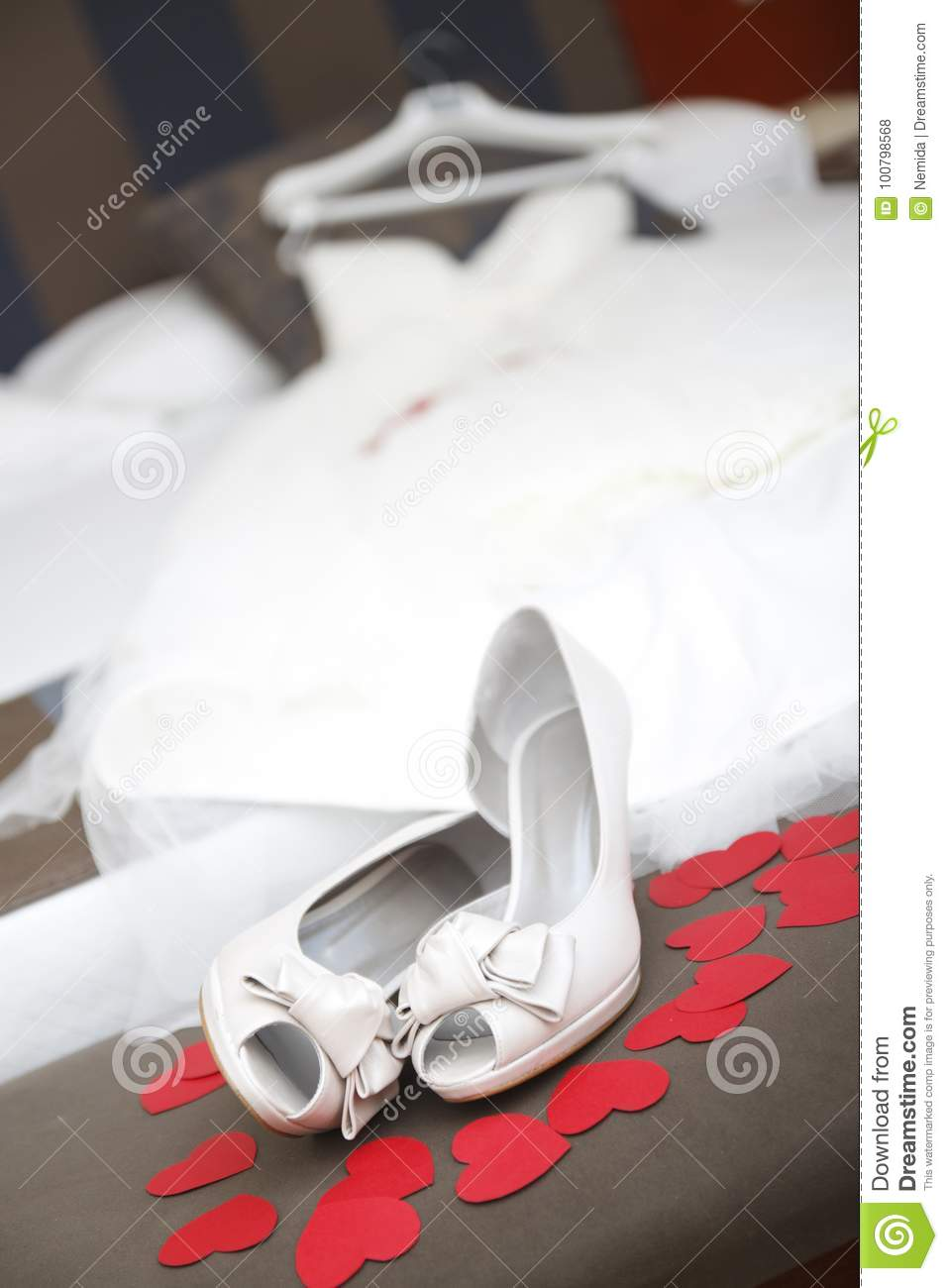 993ed538f7d4d A wedding shoes and a dress waiting on the bed.