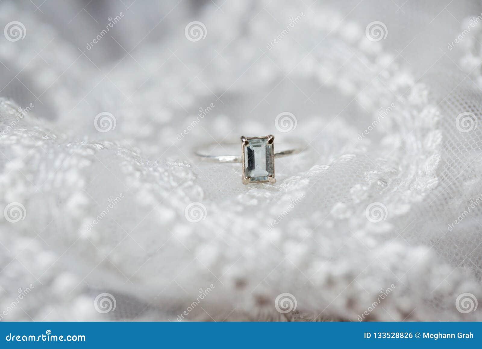Wedding engagement ring with emerald cut aquamarine gemstone a