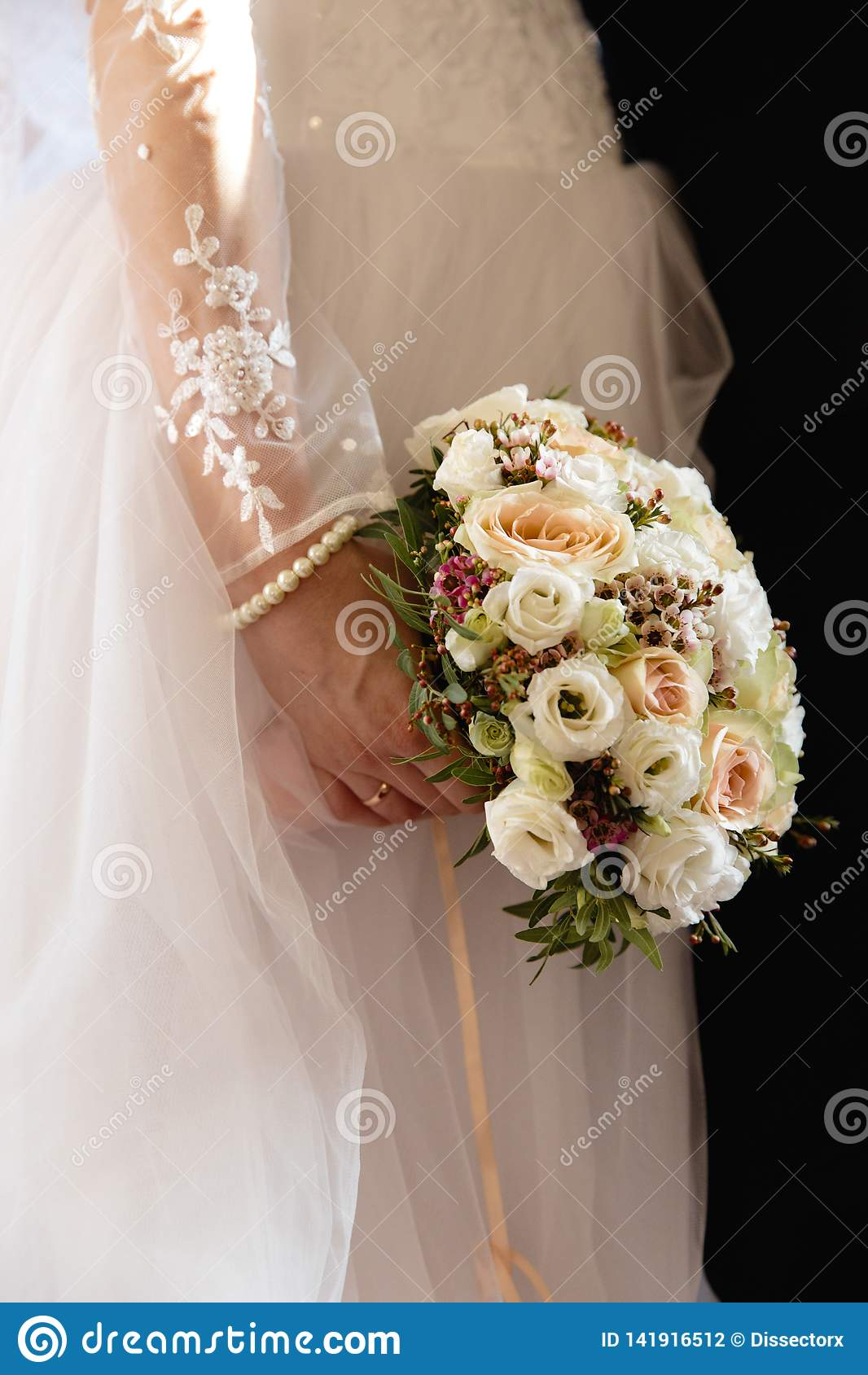 Wedding fashion portrait of young couple with nice boquet. Bride and groom in Riga, Latvia