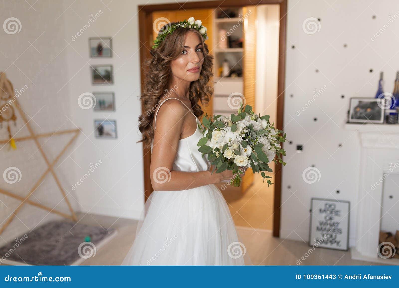 Wedding Flowers In Bride Hands In Interior Bride In A Designer D