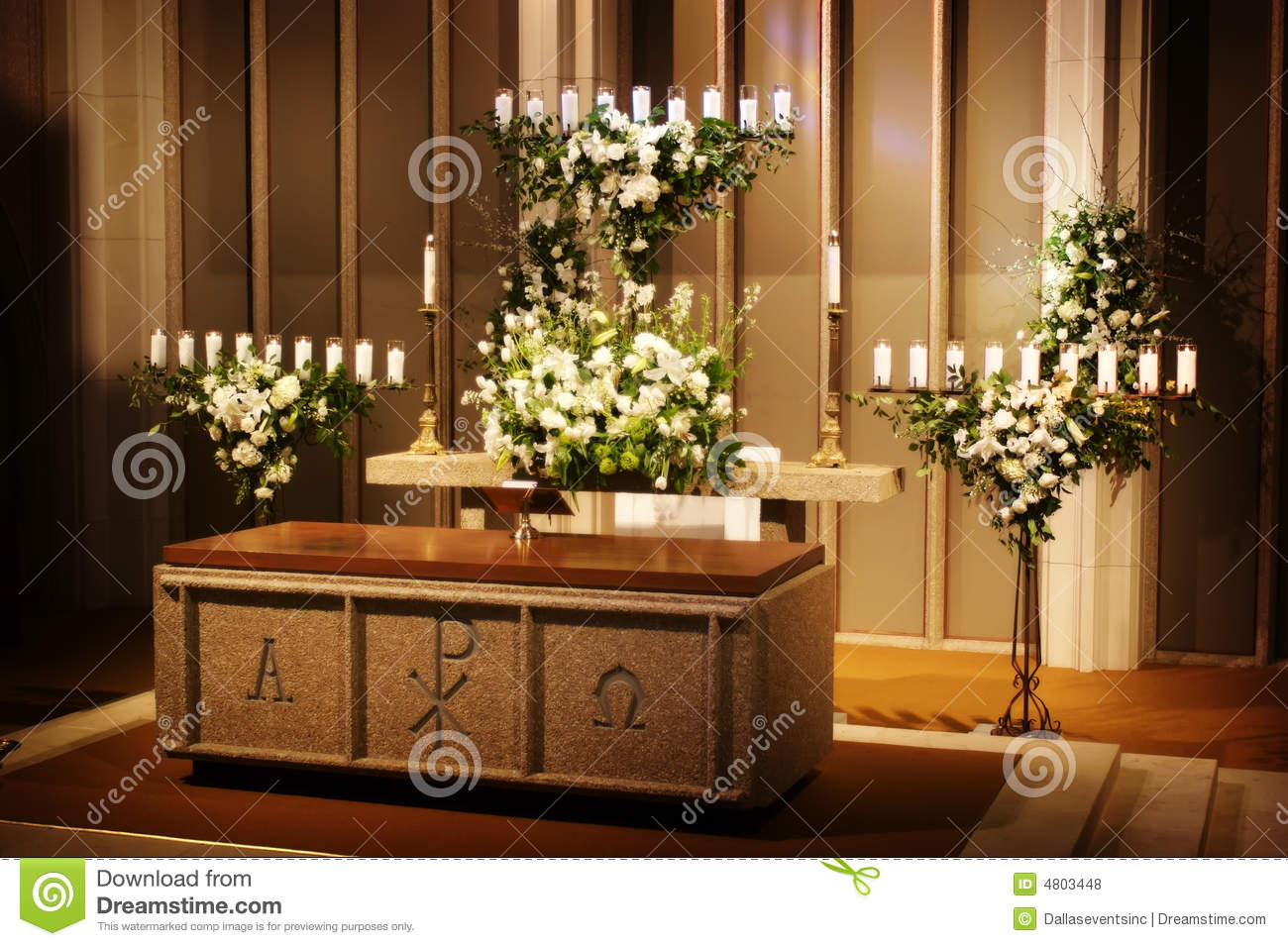 Wedding Flowers And Candles In A Church