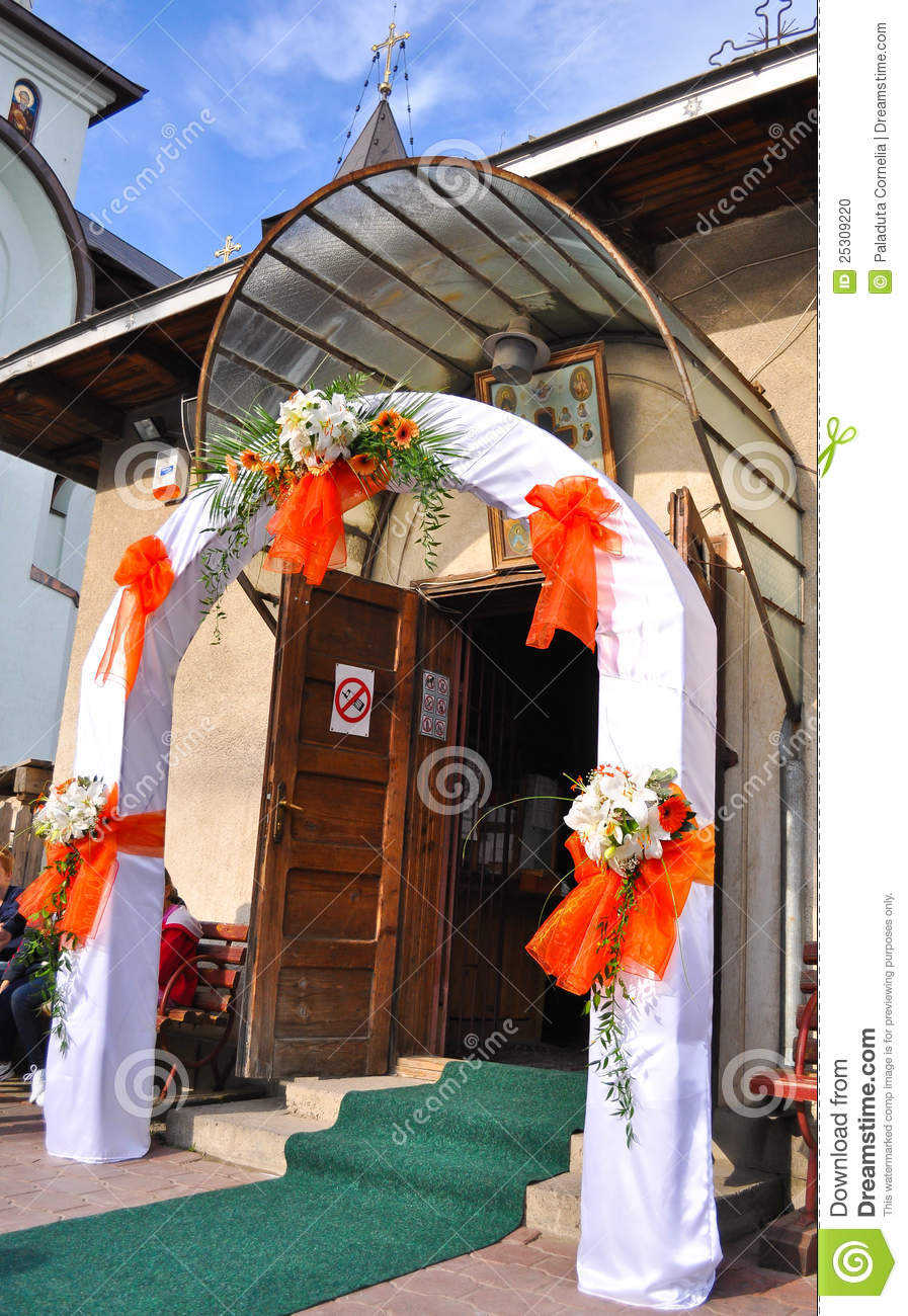 Wedding flowers on the front door of a church stock photo for Wedding door decorating ideas