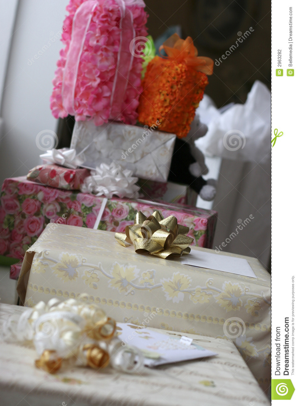 Wedding Gift List Next : Several gift-wrappped wedding gifts of various sizes next to each ...