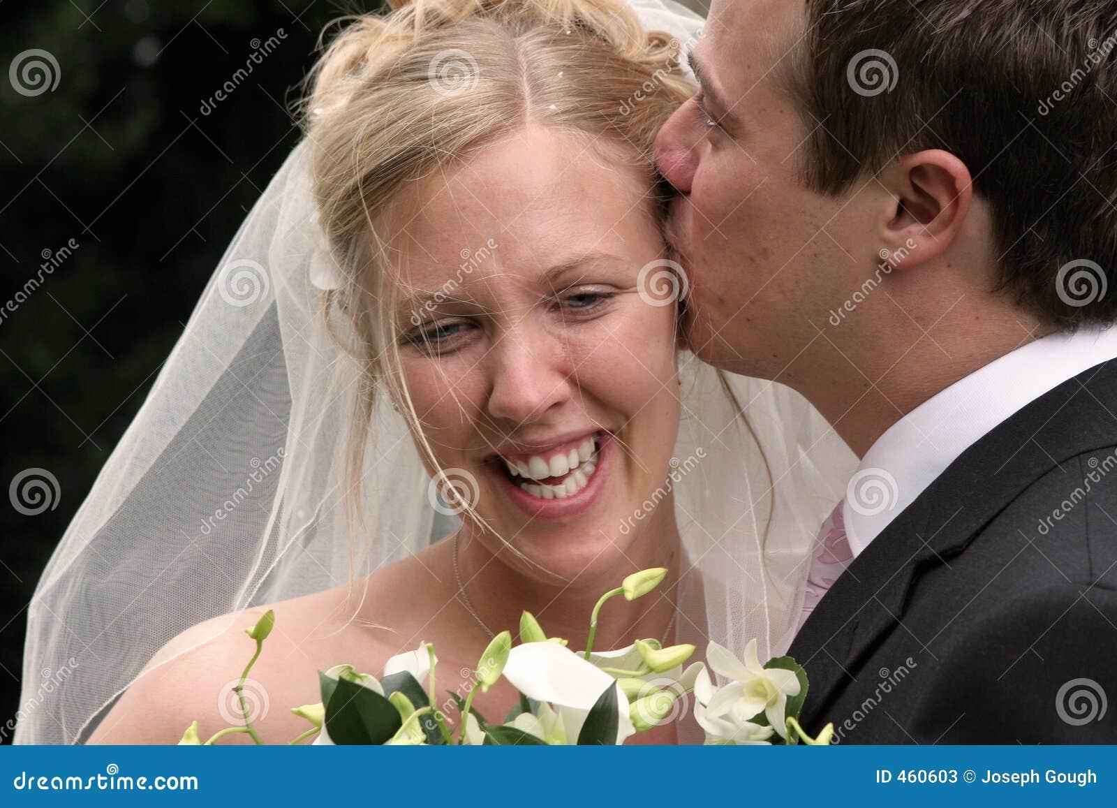 Wedding, Groom Kissing Bride