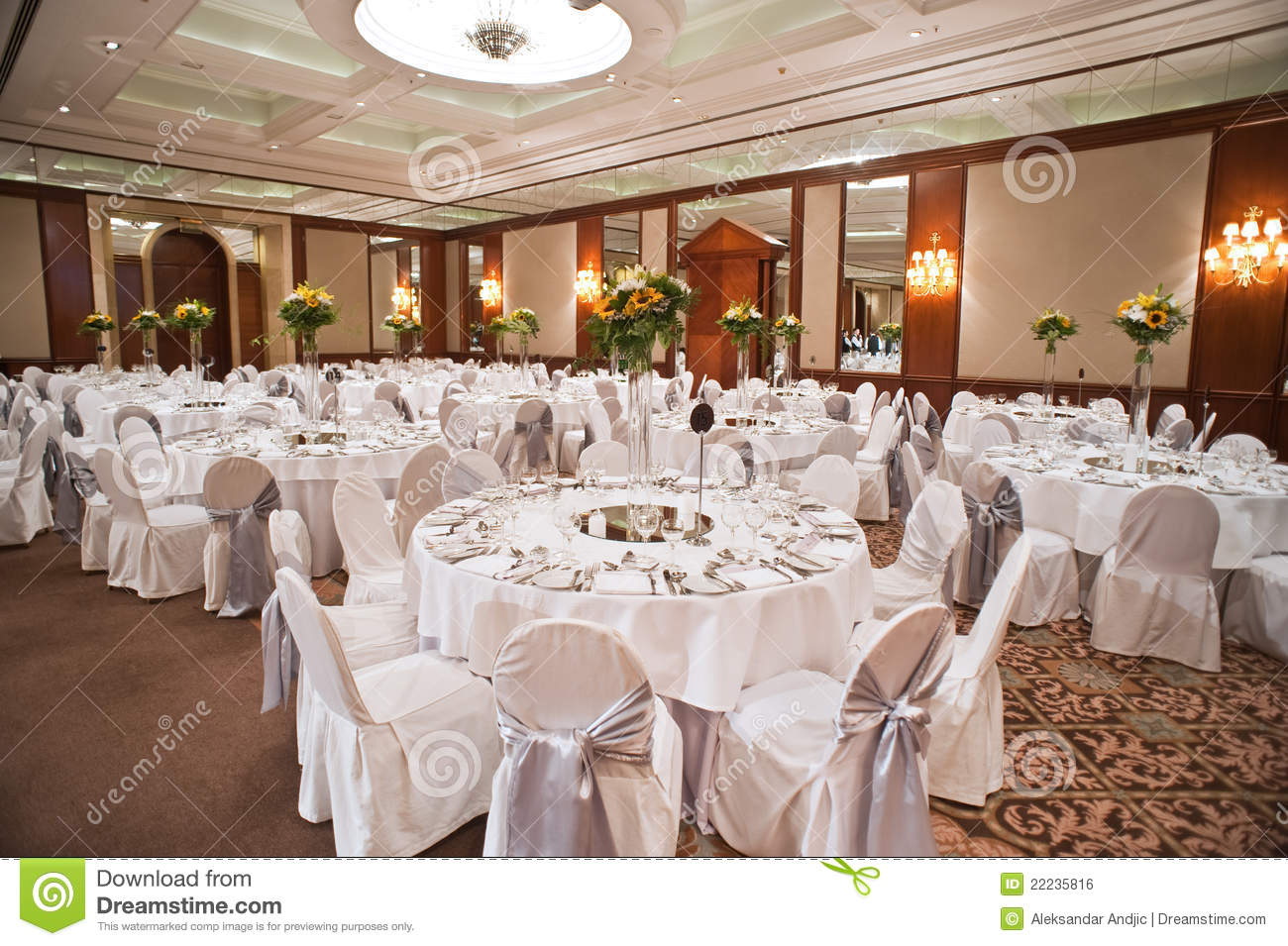 Beautifully decorated wedding hall with round tables at the hotel
