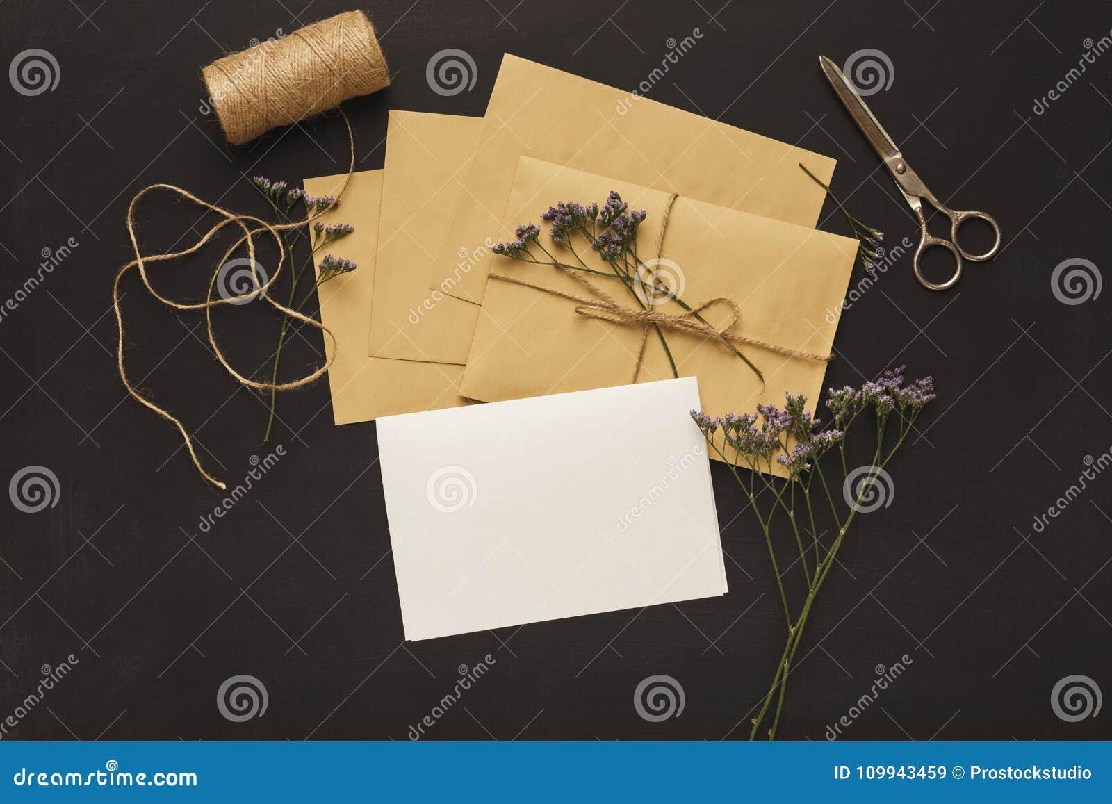 Wedding Invitation Cards And Envelopes On Black Background