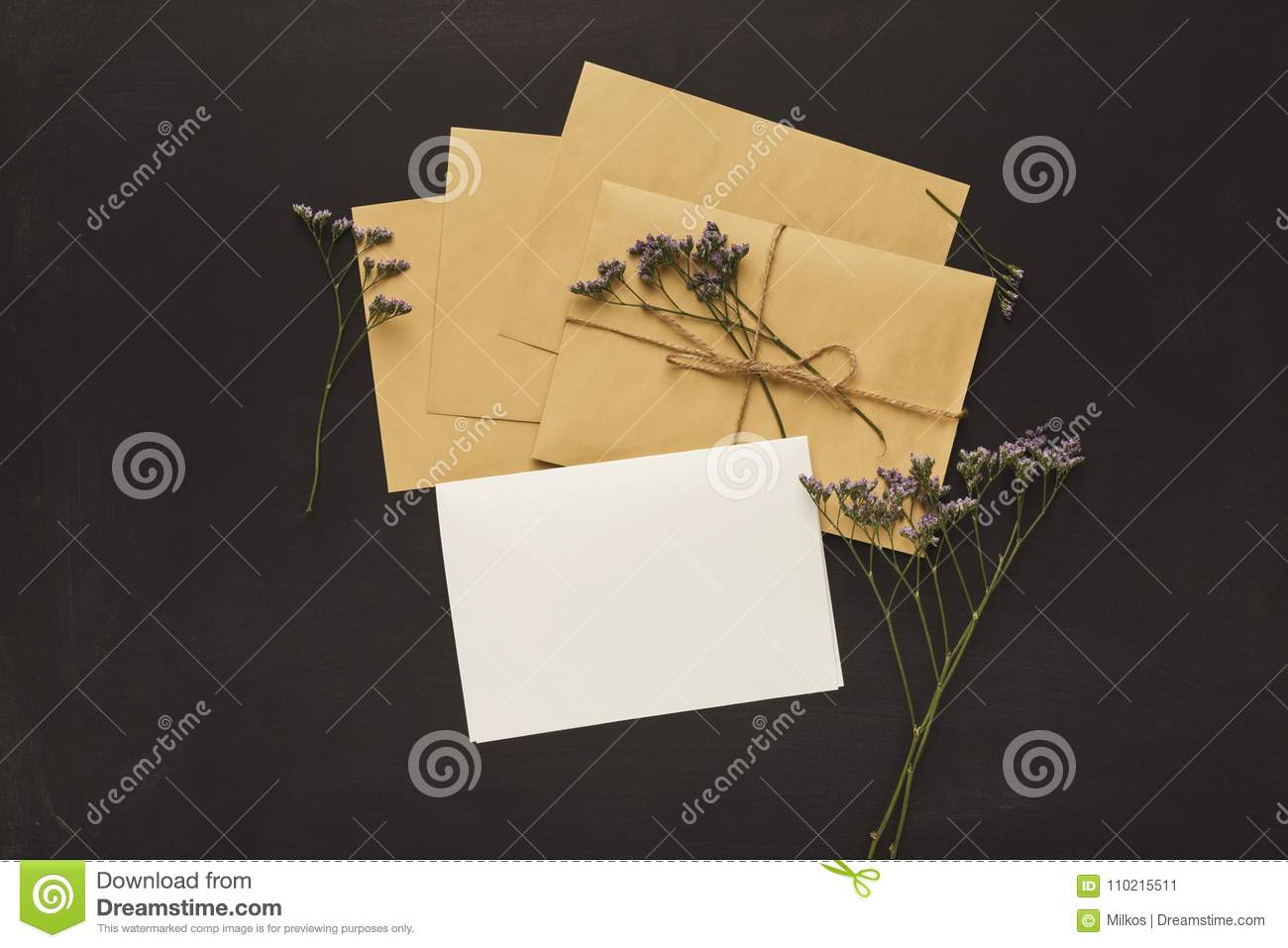 wedding invitation cards and envelopes on black background stock