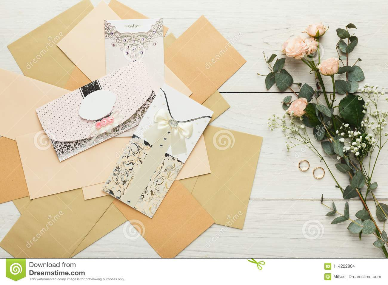 Wedding Invitation Cards And Envelopes On White Wooden Table, To ...