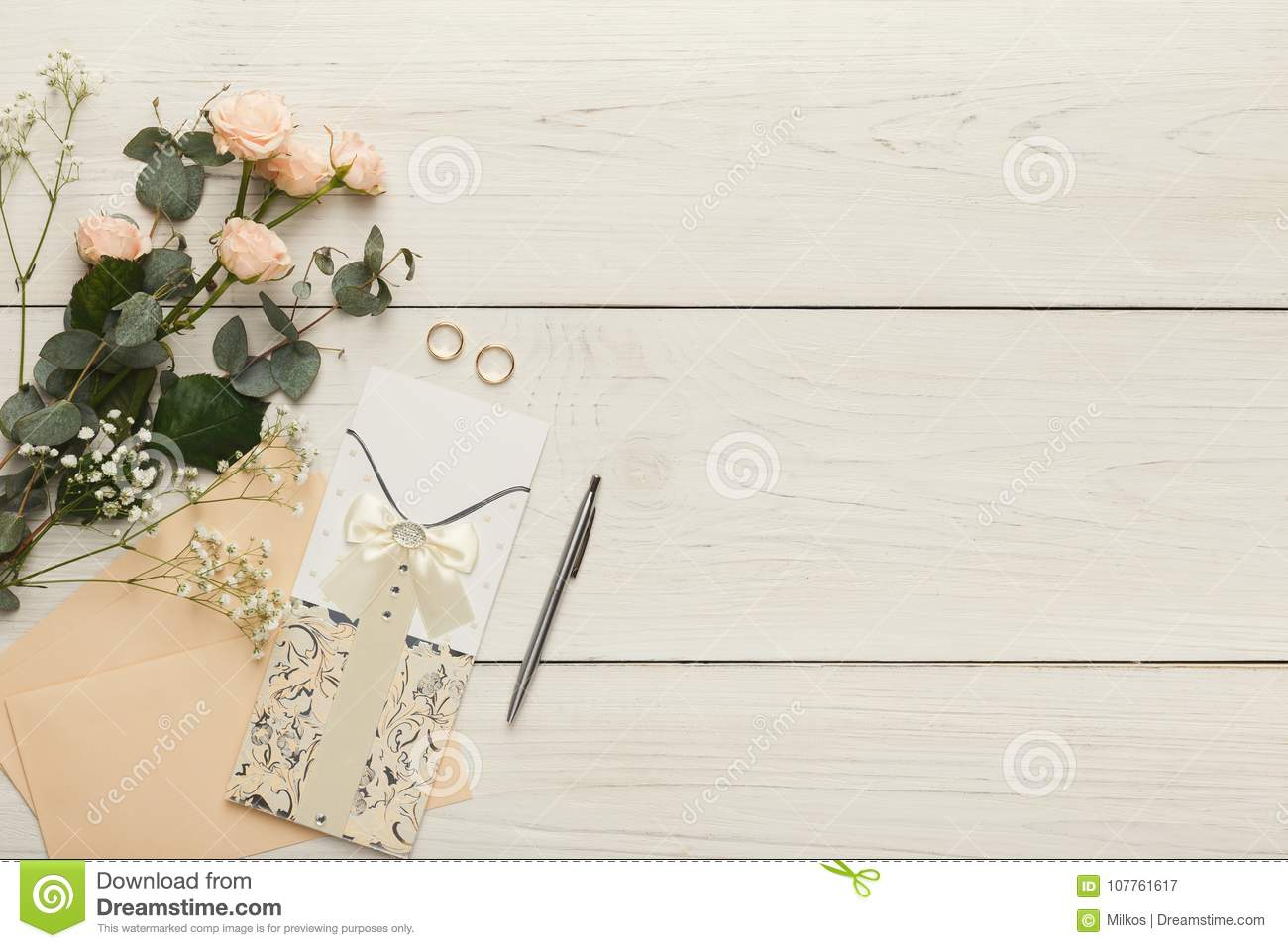 Wedding Invitation Cards And Envelopes On White Wooden Table, Top ...
