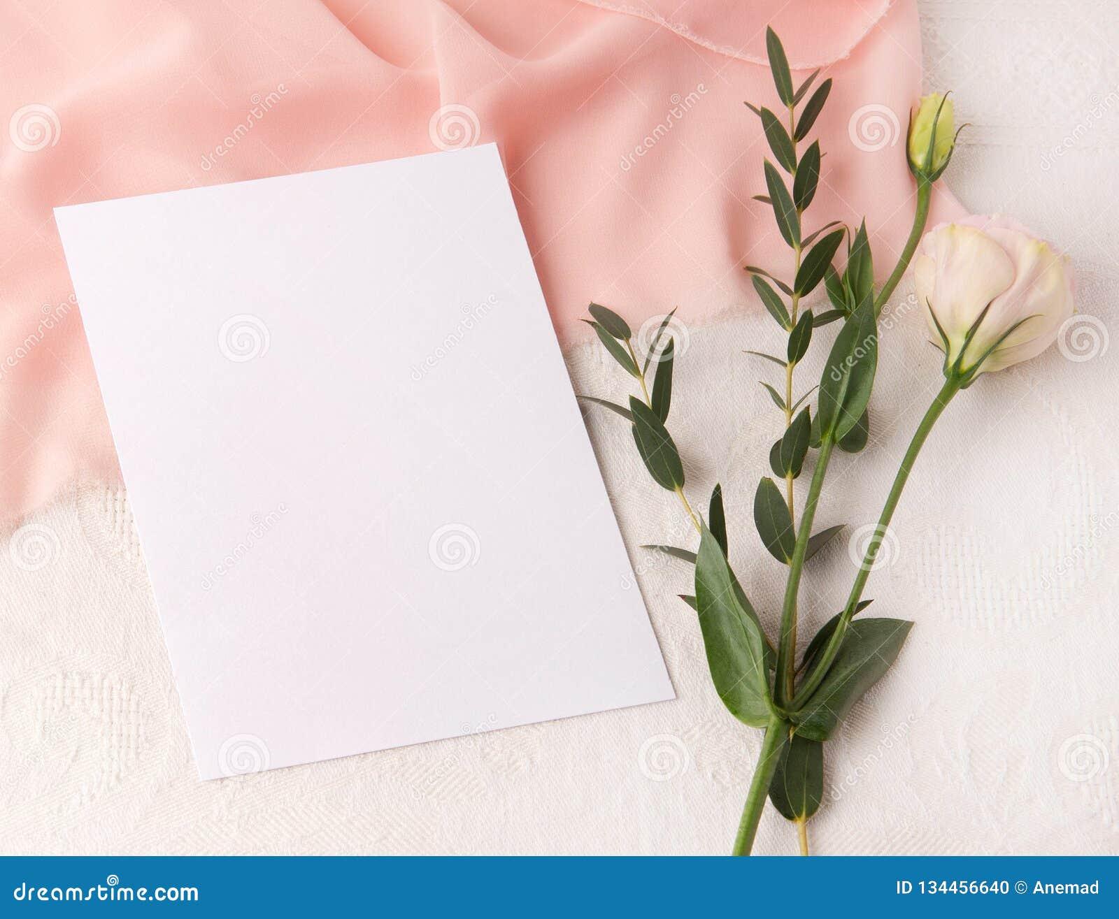 Wedding Invitation Mockup With Blush Silk And Flowers Stock Photo