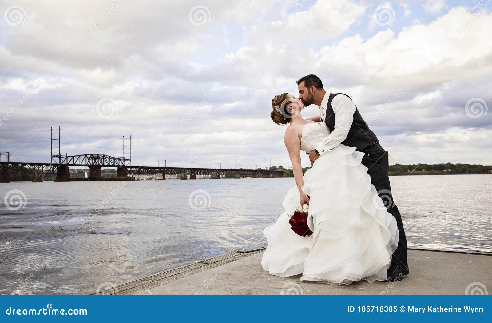 Wedding kiss on dock