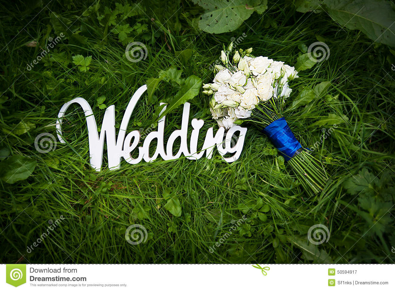 wedding letters with white flowers on grass