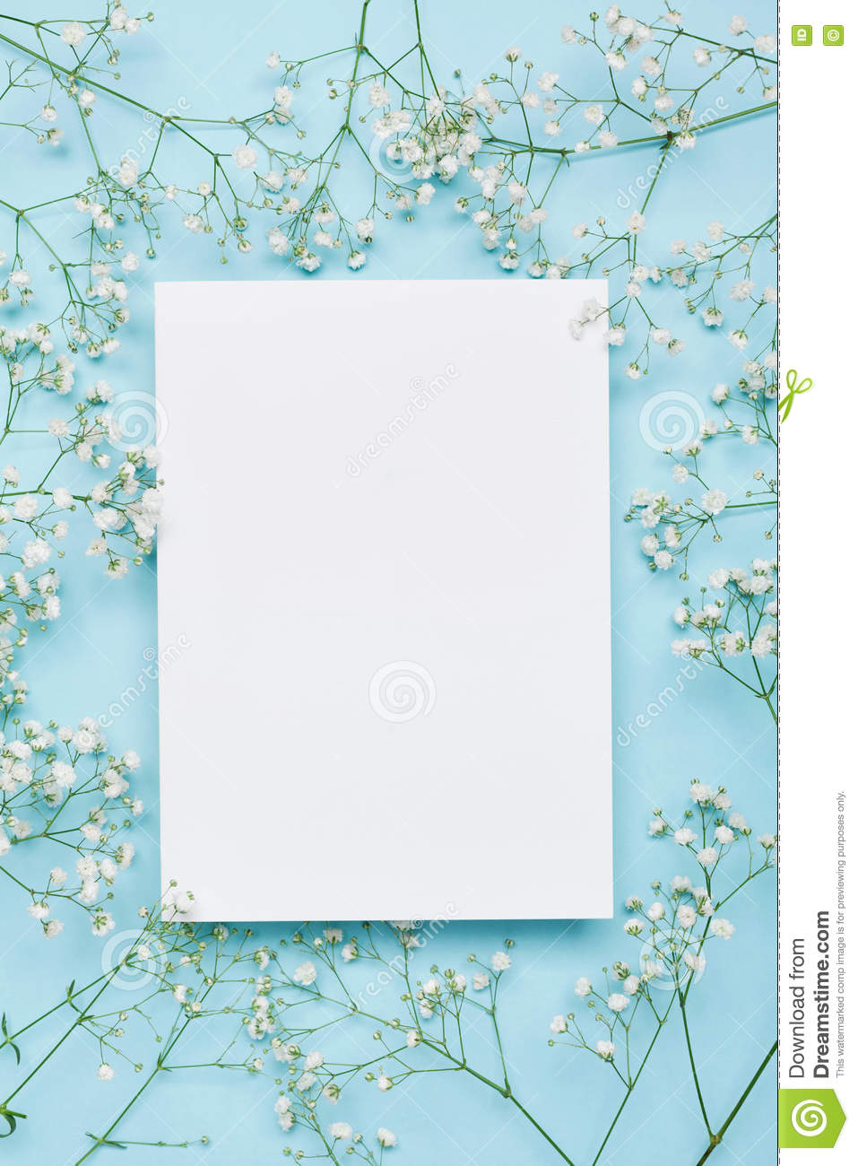 Wedding mockup with white paper list and flowers gypsophila on blue download wedding mockup with white paper list and flowers gypsophila on blue background from above izmirmasajfo