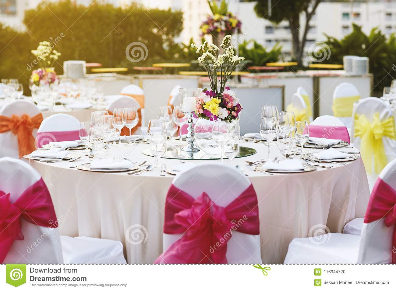 Warm Sunset Light With Wedding Reception Dinner Table Setting With Empty  Glasses Of Water, Wine And Dinnerwear With Flower Decoration, And White  Fabric ...