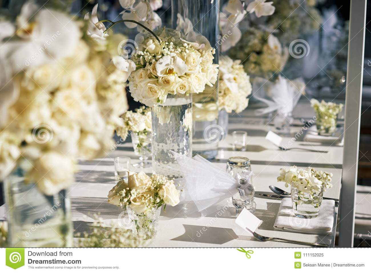 The White Cream Roses Orchids Decoration On The Reception Dinner