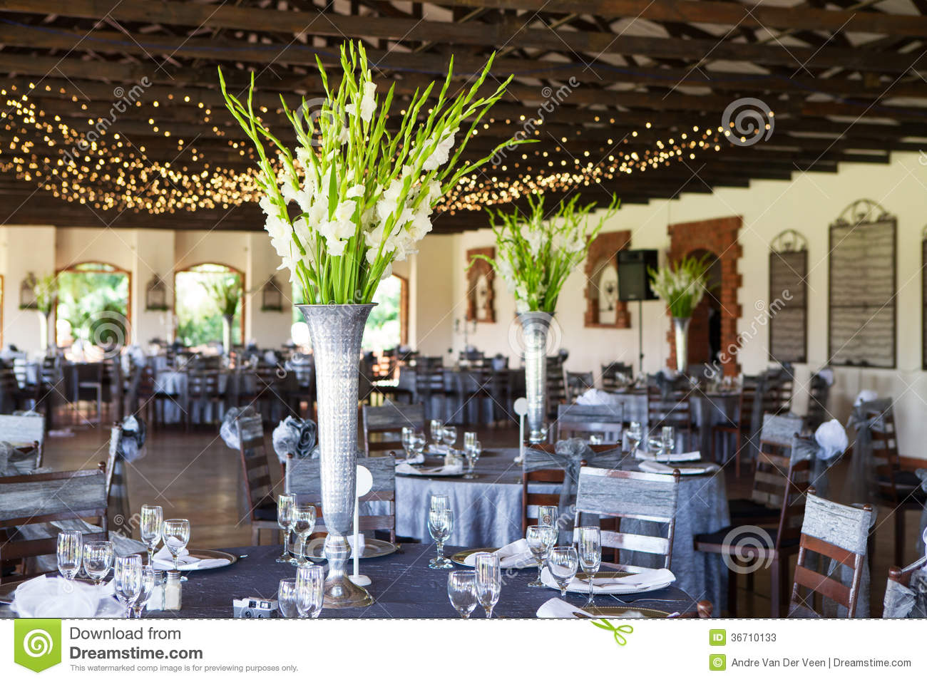 Wedding Reception Venue With Decorated Tables And Fairy