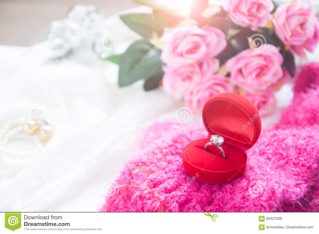 Wedding Ring, Diamond Ring In Red Box With Pink Roses Stock Image ...