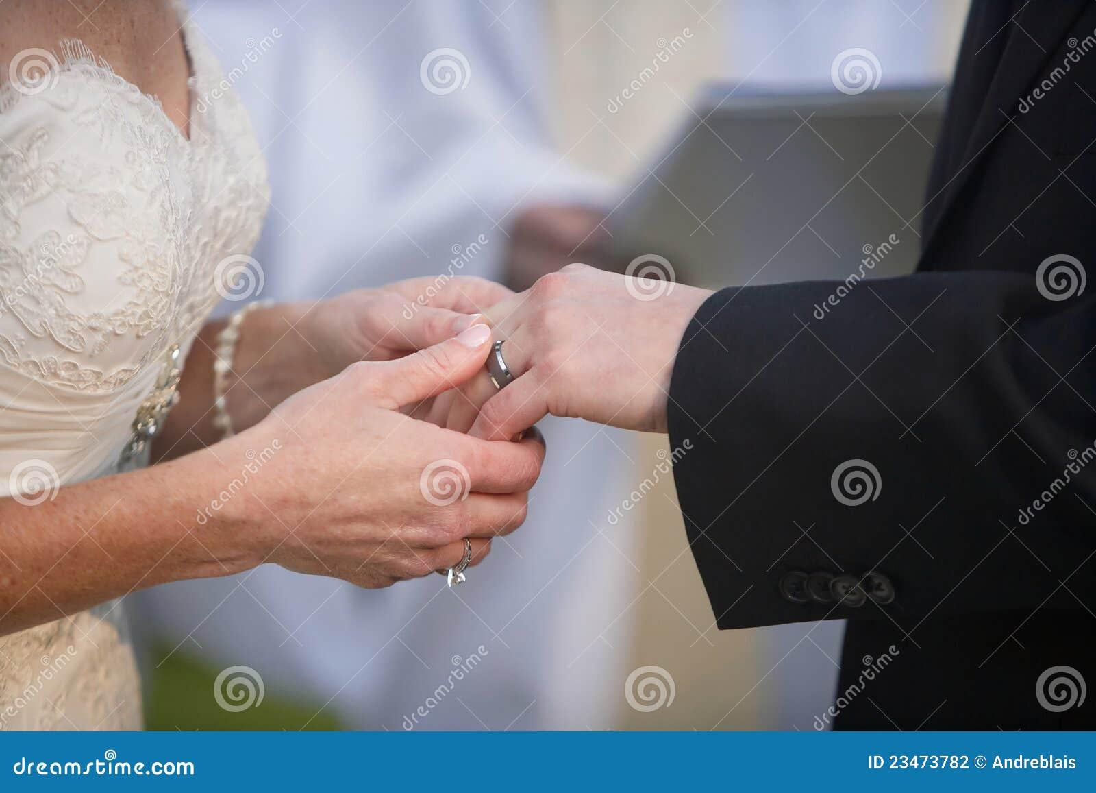 Man Putting Ring On Lady. Stock Photo