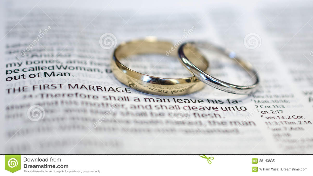scripture on a bible photo two stock wedding rings