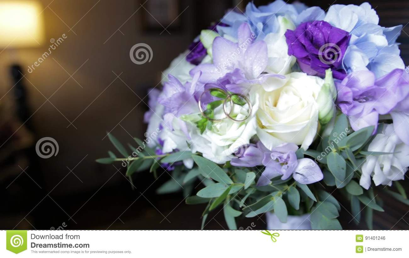 Wedding Rings On A Bouquet Of White Flowers. Wedding Rings And ...