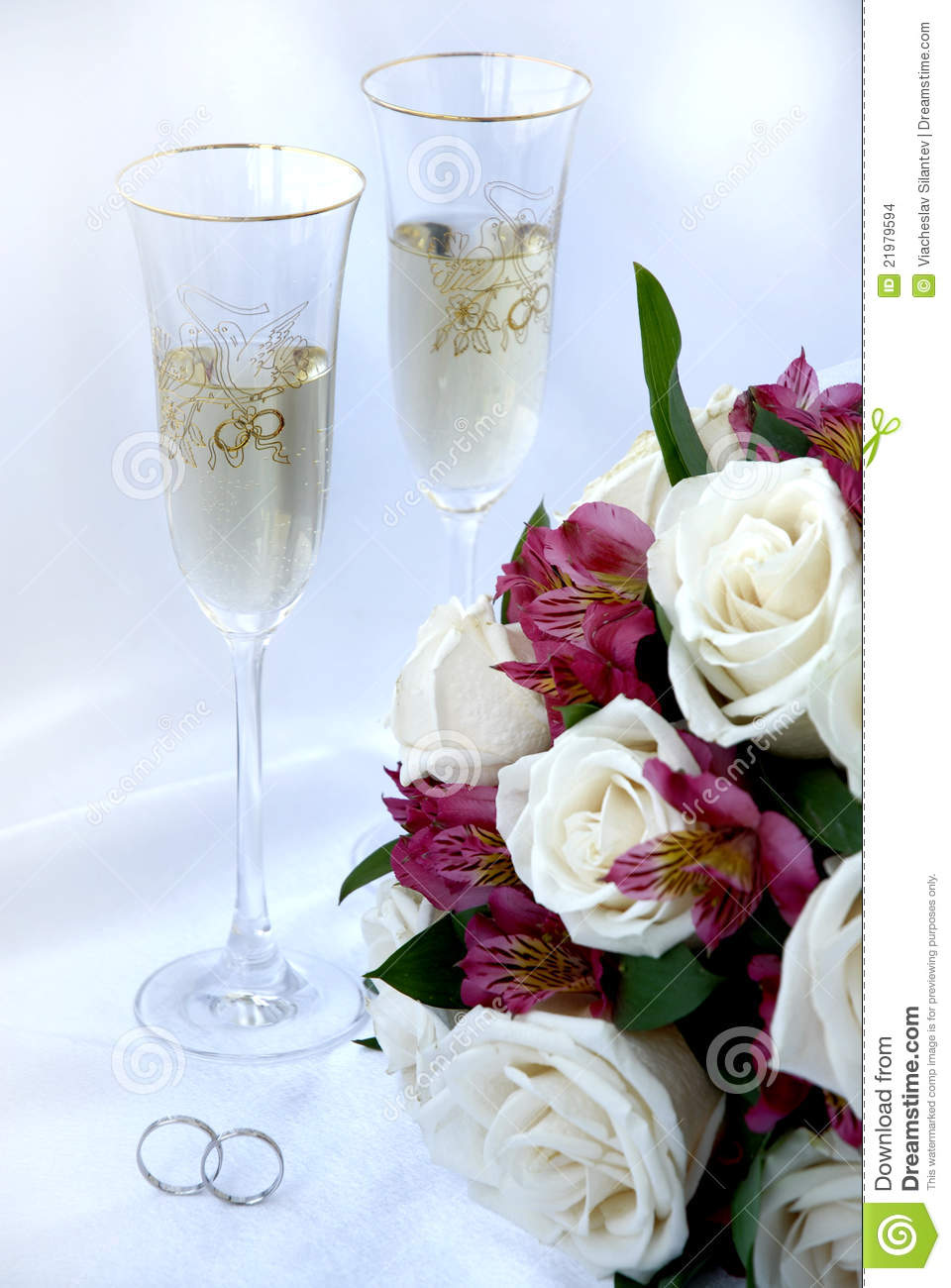 Wedding Rings Champagne And Flowers Stock Photo Image