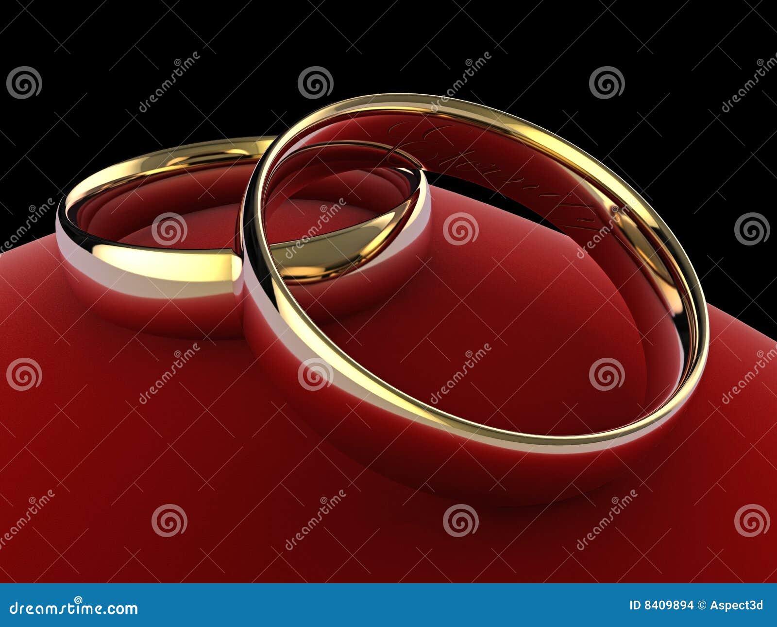 Wedding rings on cushion (eternity engraved)