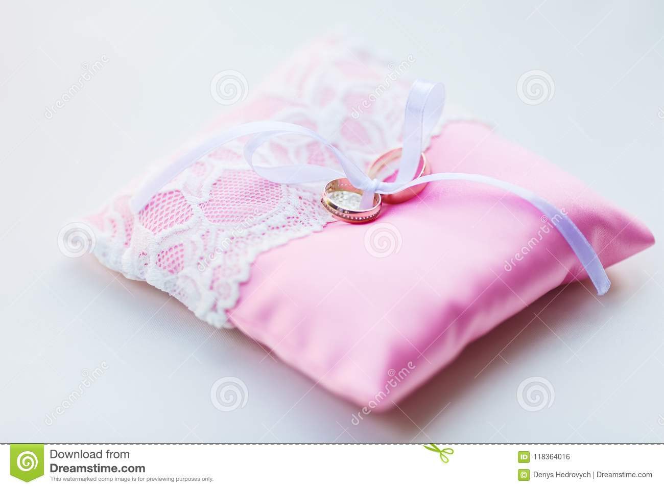 Wedding Rings With Diamonds Lie On The Pink Ceremonial Pillow Stock ...