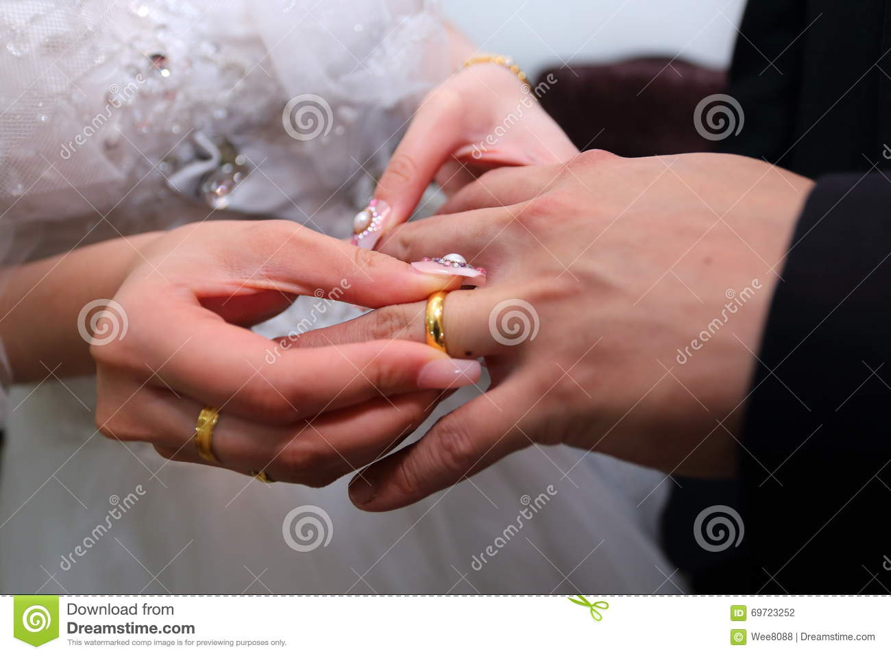 Wedding rings exchange stock photo. Image of romantic - 69723252