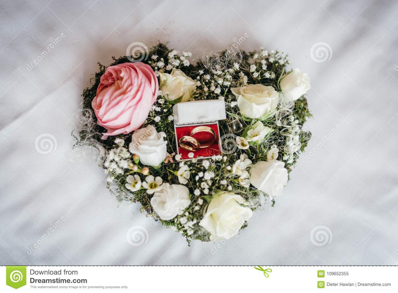 Wedding rings in a floral bouquet stock image image of anniversary wedding rings in a floral bouquet izmirmasajfo