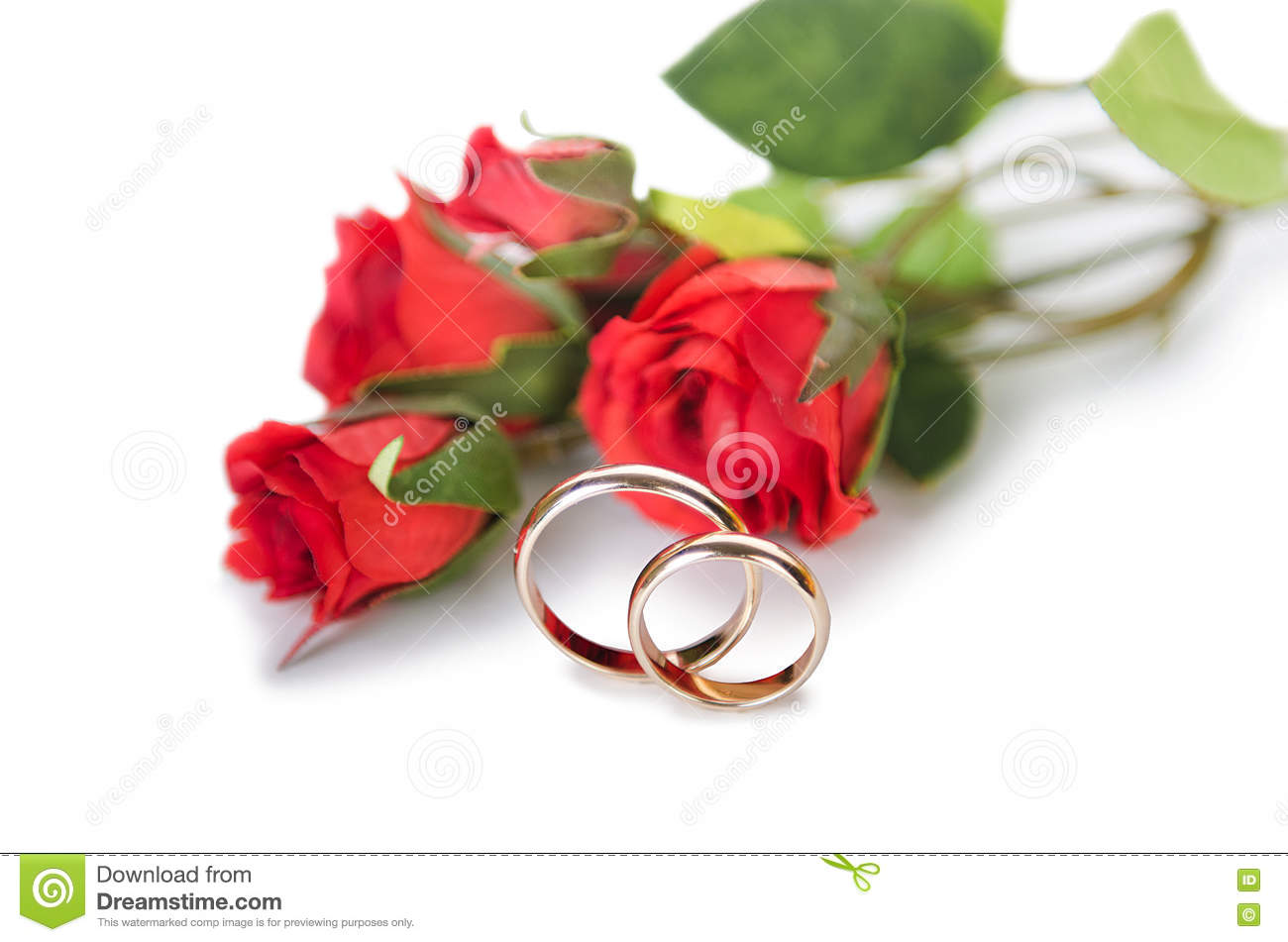 The Wedding Rings And Flowers Isolated On White Background Stock
