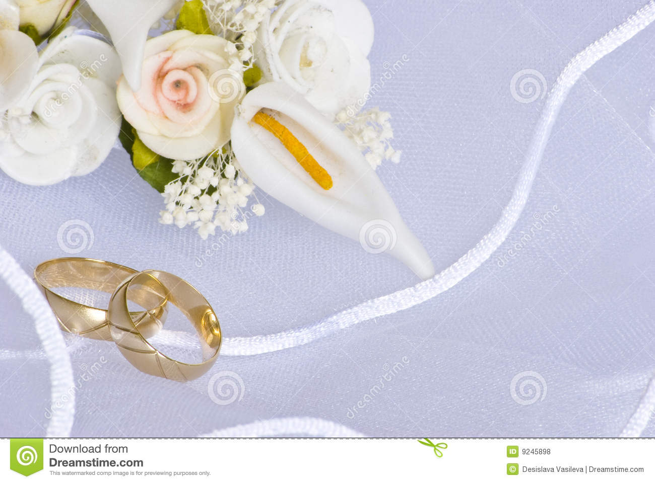 Wedding Rings And Flowers Over Veil Stock Photography Image 9245982
