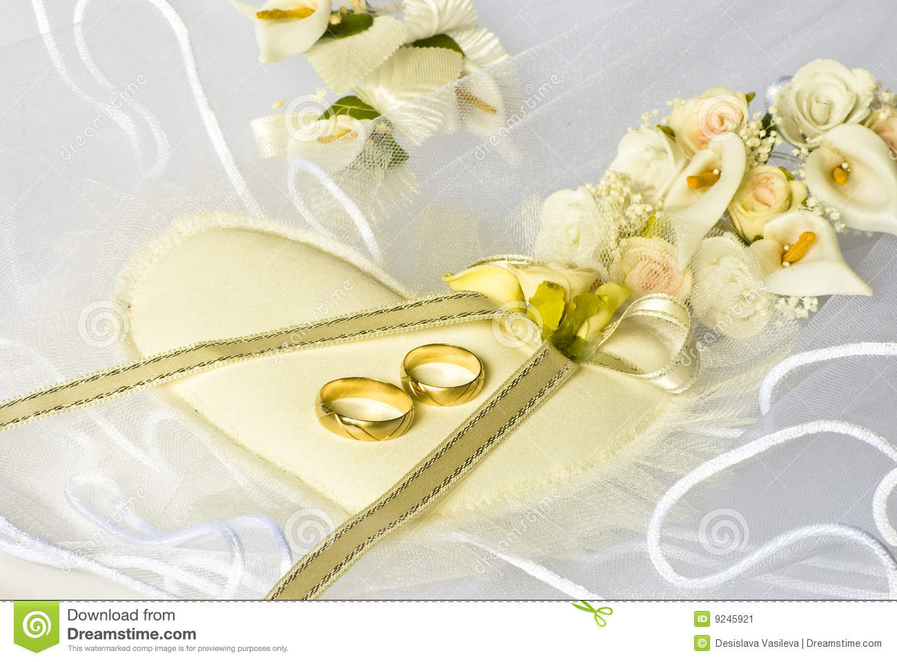 wedding rings and flowers over veil stock image image