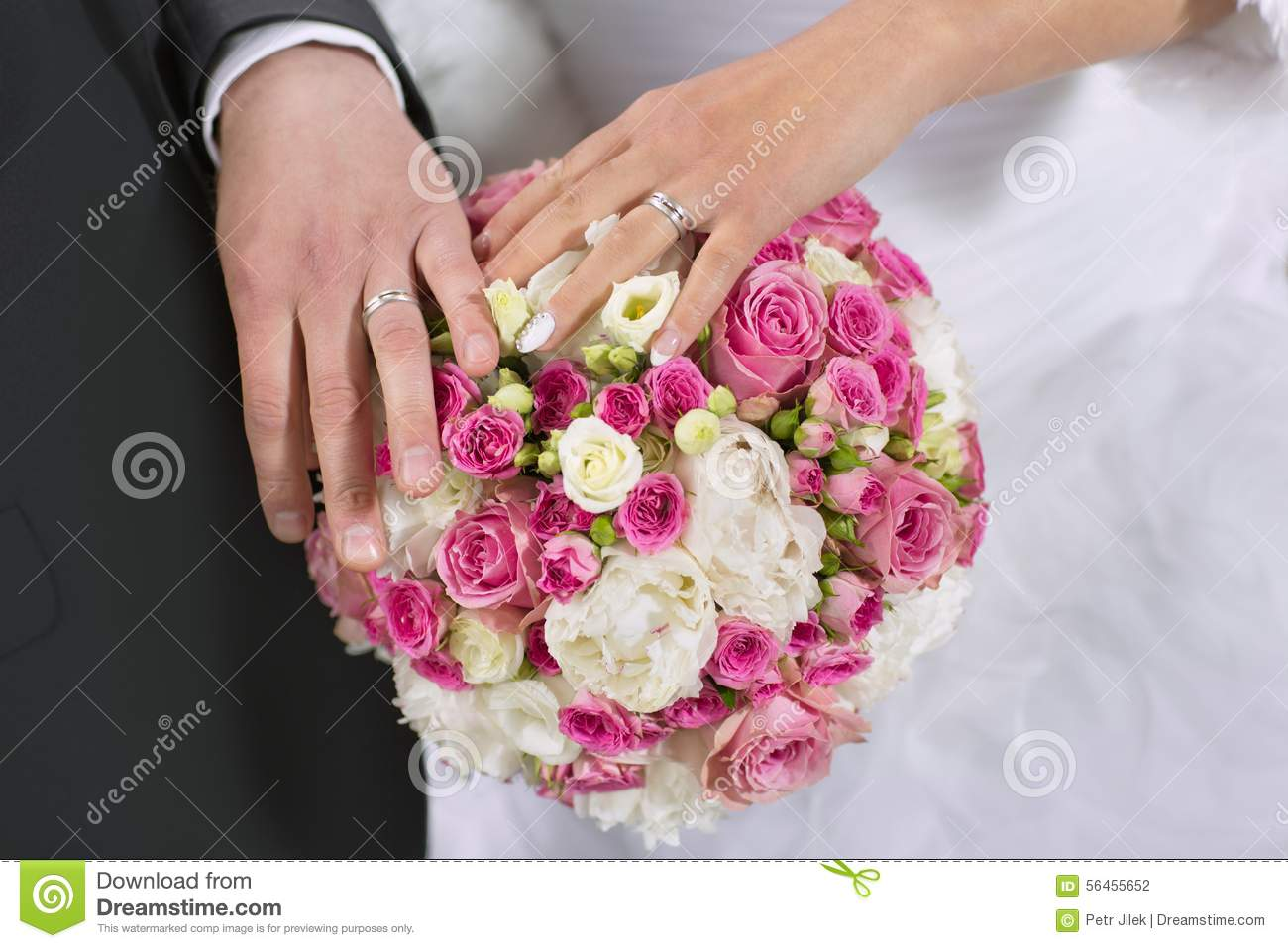 Wedding Rings Hand And Flowers In The Wedding Photo Stock Photo