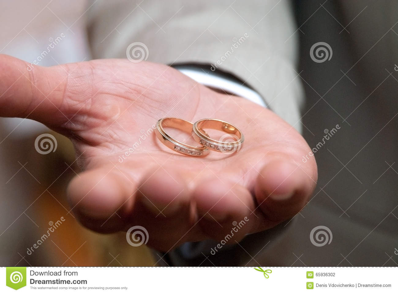 Wedding rings in man hand stock photo. Image of jewelry - 65936302