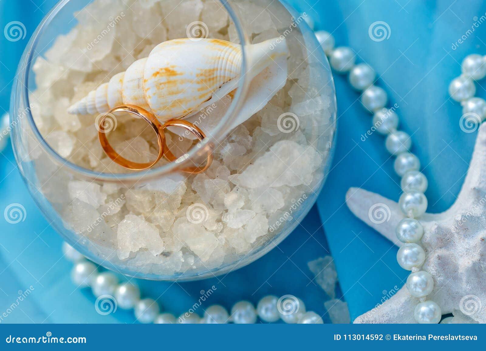Wedding rings, nautical theme, starfish and pearl