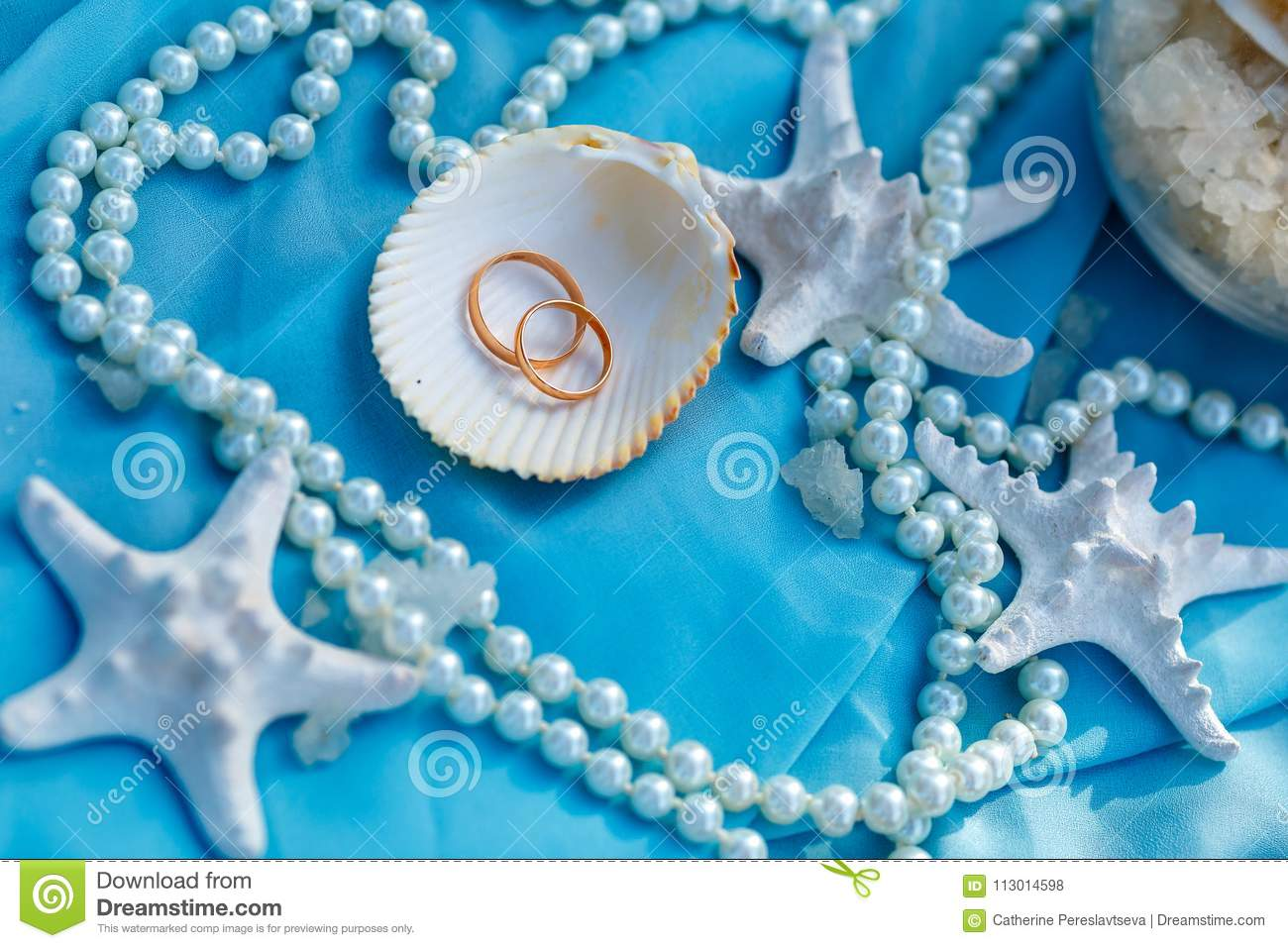 Wedding rings, nautical theme, starfish and pearl