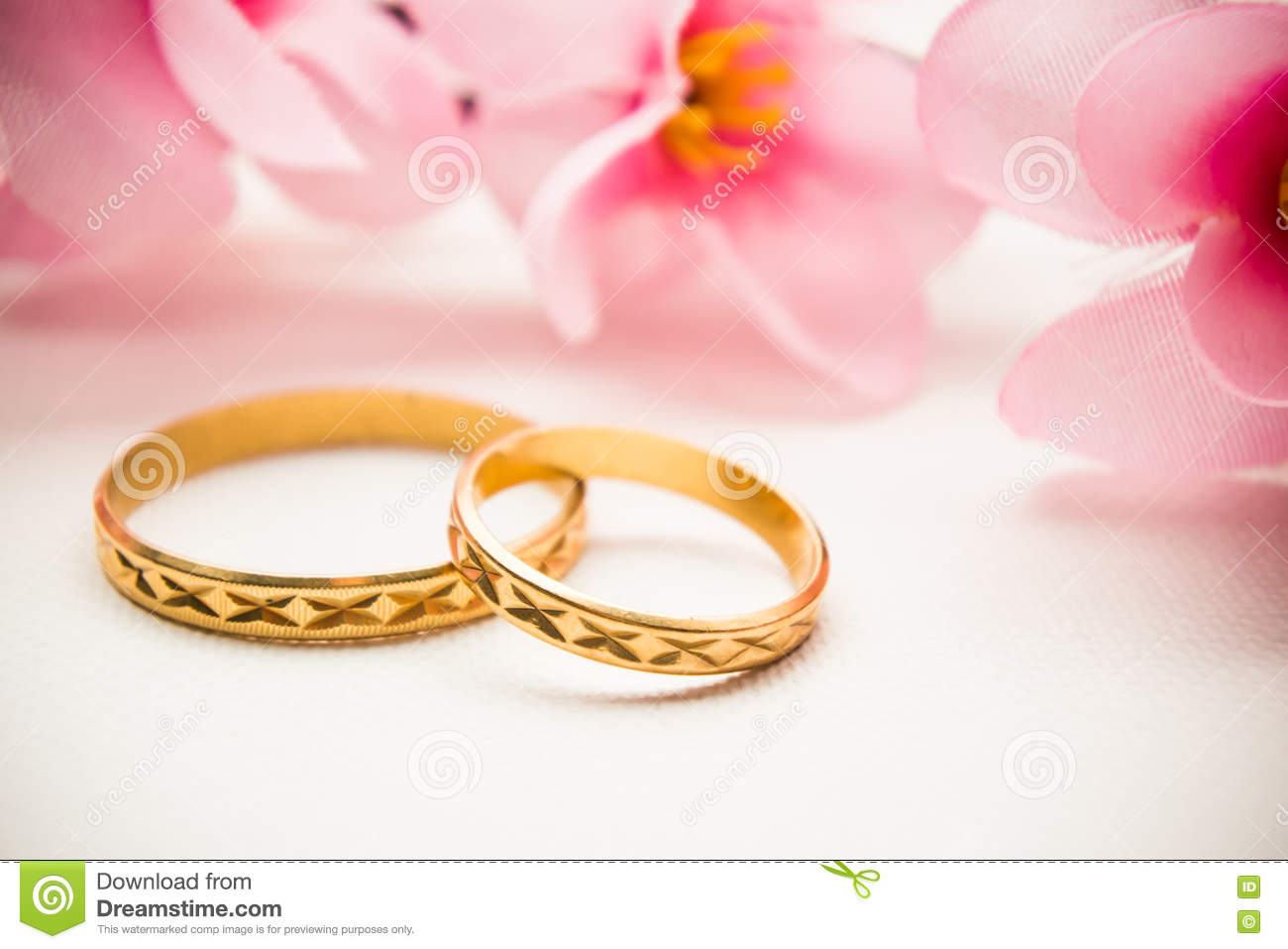 Wedding Rings And Pink Flowers Background Stock Image - Image of ...