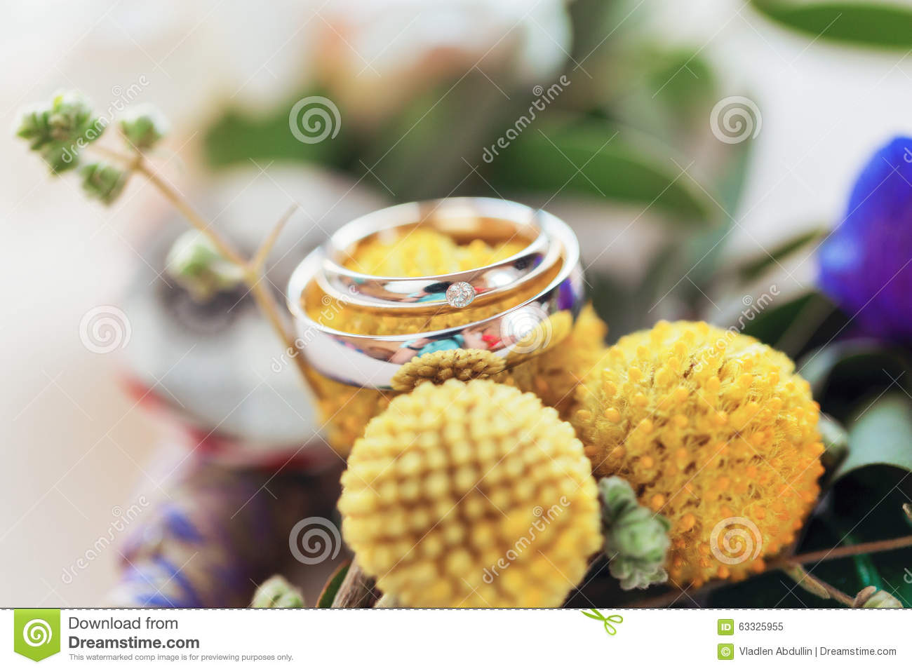 Wedding rings round yellow flowers stock image image of symbol wedding rings round yellow flowers mightylinksfo