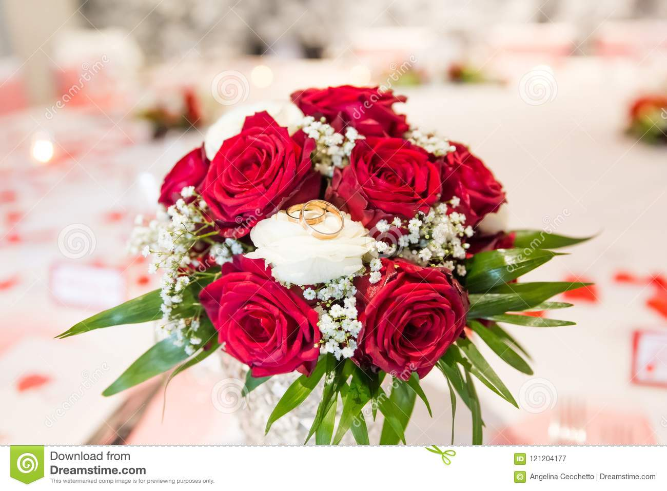 Wedding Rings On White And Red Roses Bridal Bouquet Stock Image