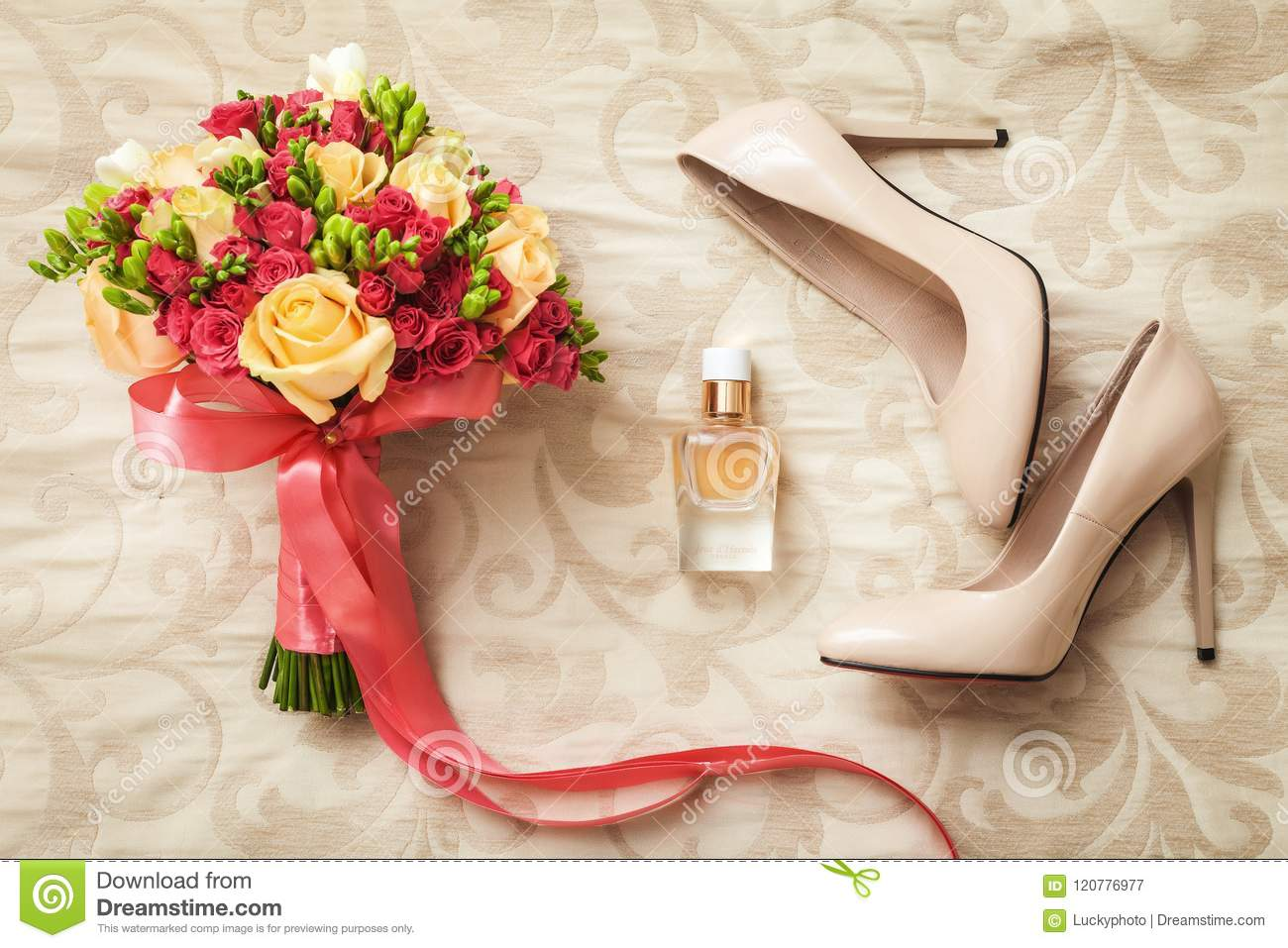 Wedding set of bridal bouquet, white shoes and perfume