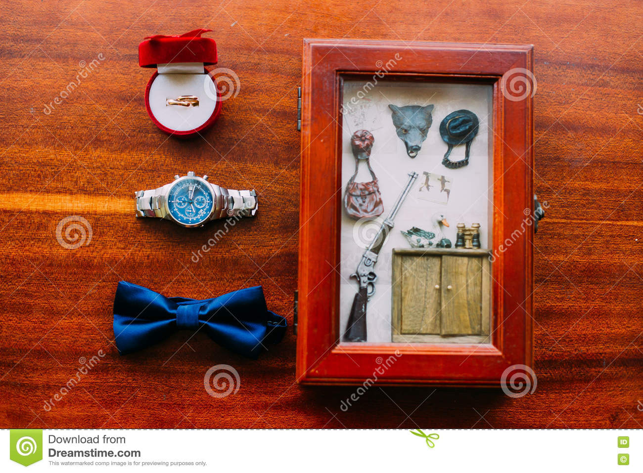 847cf800c8c Wedding set of men`s stylish watch and bow-tie on a brown wooden background  with wedding rings and postcard in rustic style.