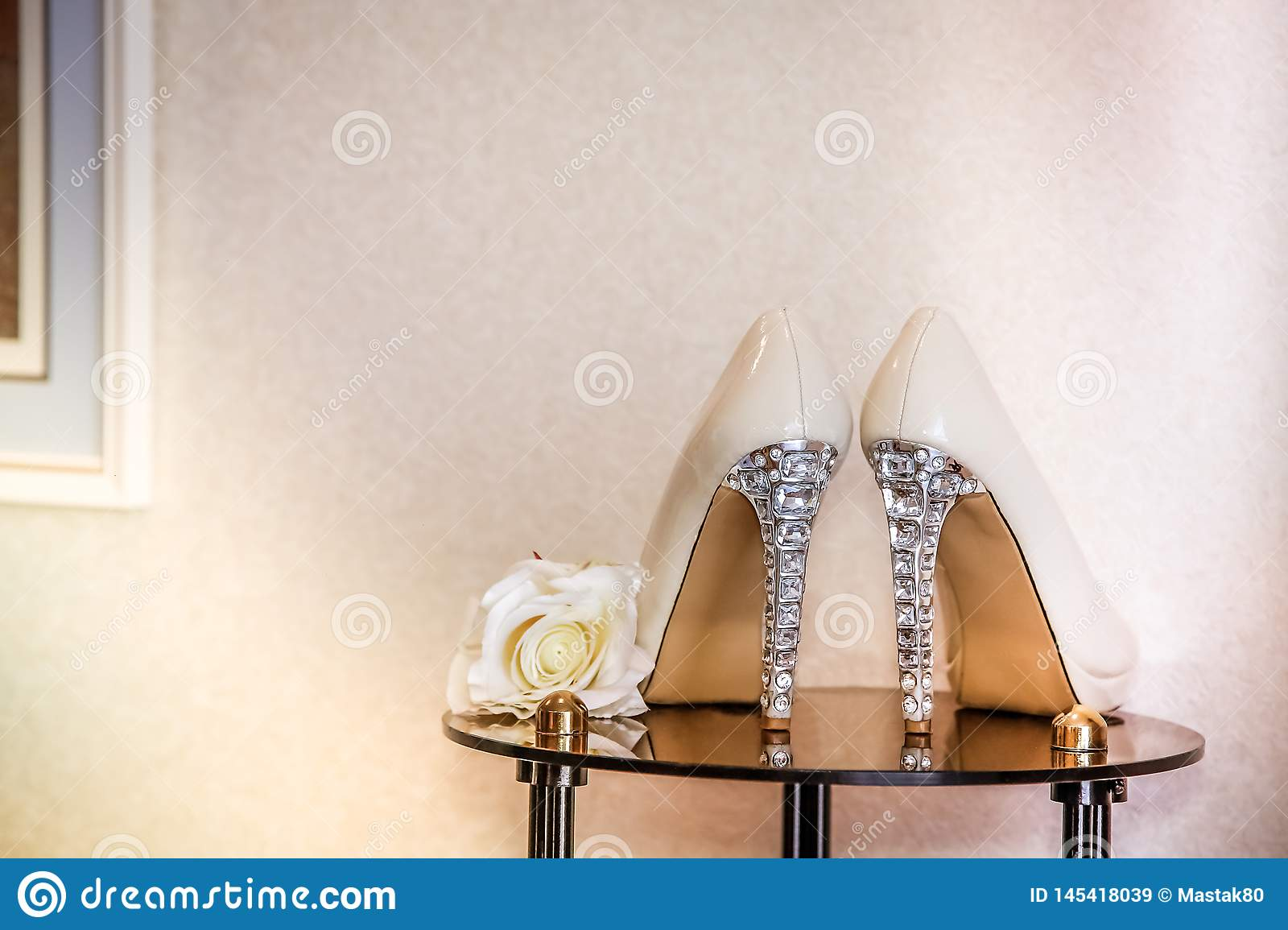 Wedding shoes beige high-heeled decorated with precious stones