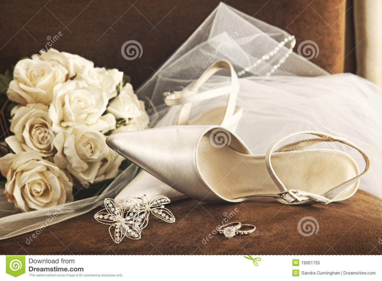 wedding shoes with bouquet of white roses and ring stock