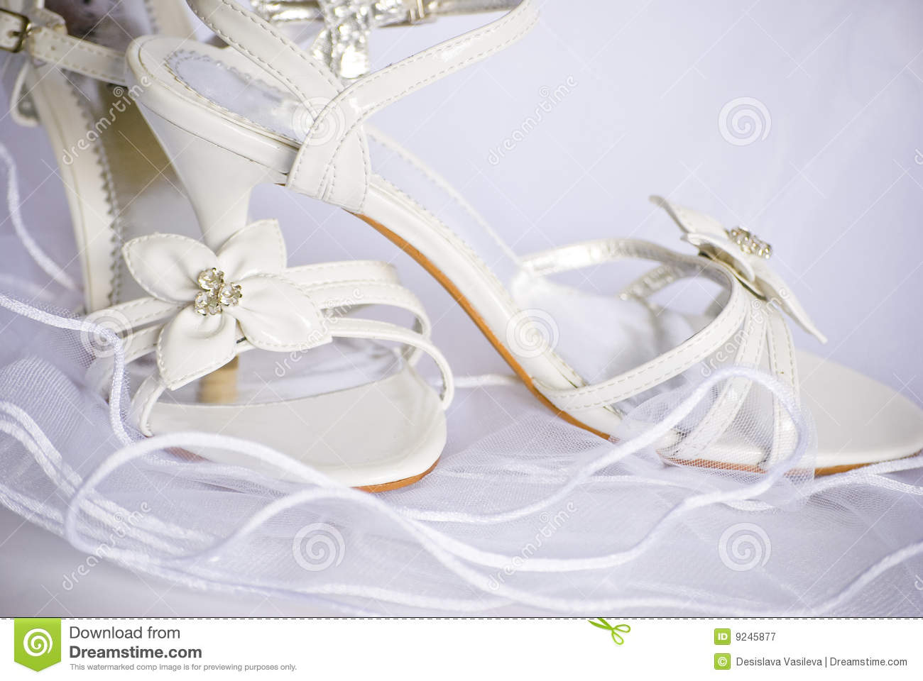 bcc055191b481 Royalty-Free Stock Photo. Wedding shoes with flowers over veil